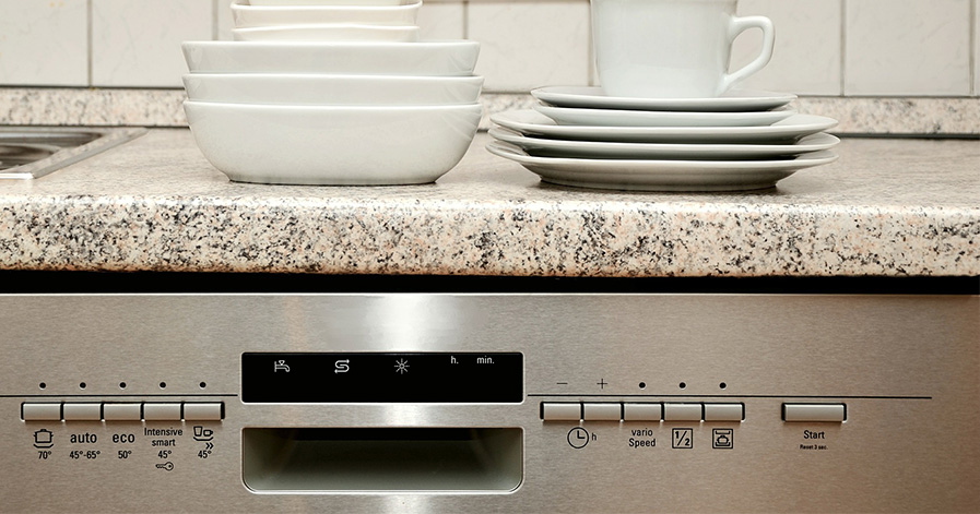 Dishwasher with plates and bowls on counter