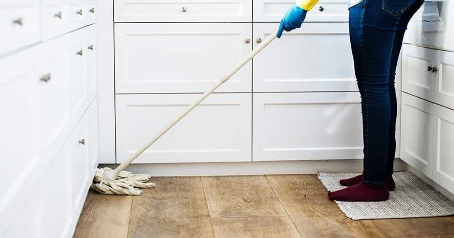 Someone mopping floor in kitchen