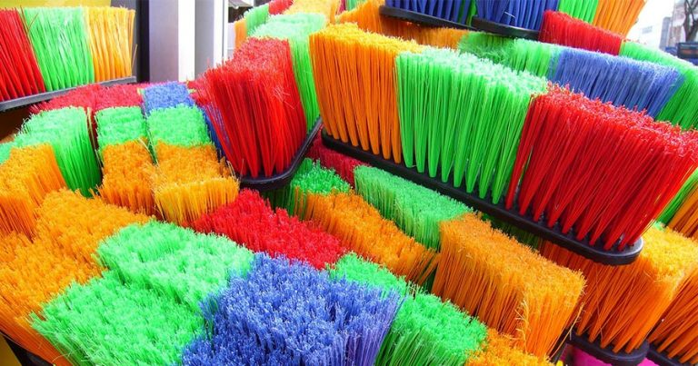 Colorful bristled brooms