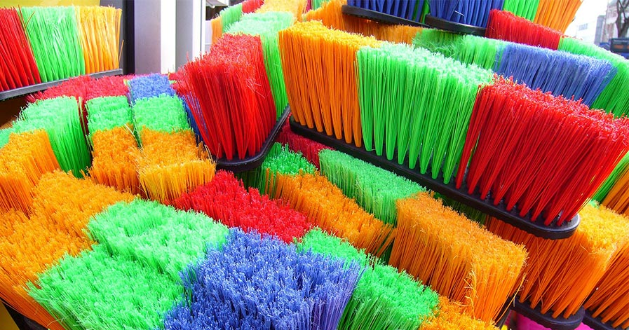 Colorful bristled brooms
