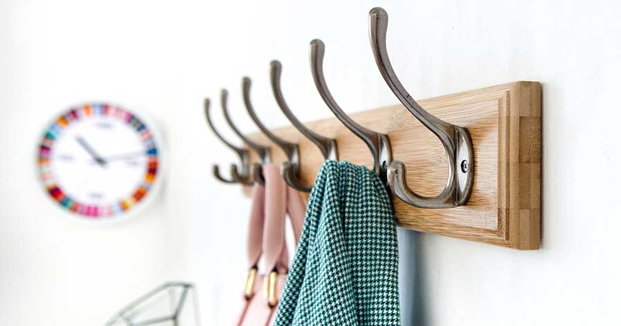 Coat and purse hanging on hooks