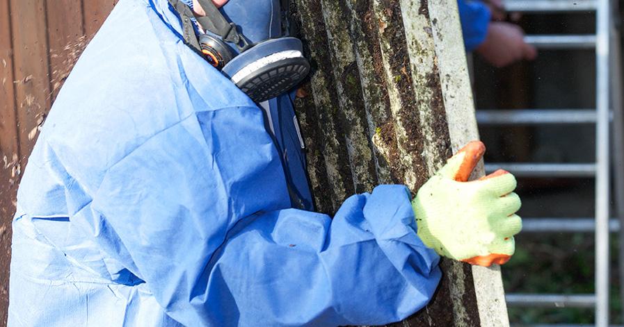 a worker removes hazardous waste