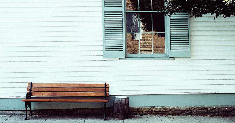 Siding on a house with bench