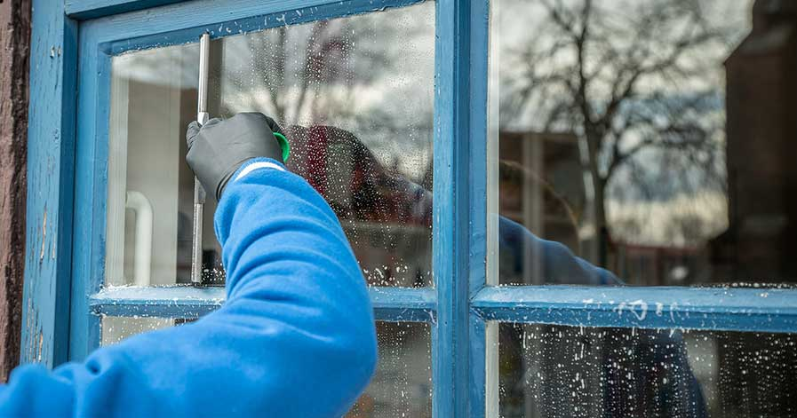 Someone cleaning windows