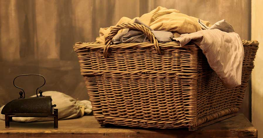 Wicker laundry basket filled with clothes