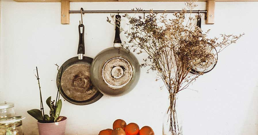 Pots hanging from rack in kitchen