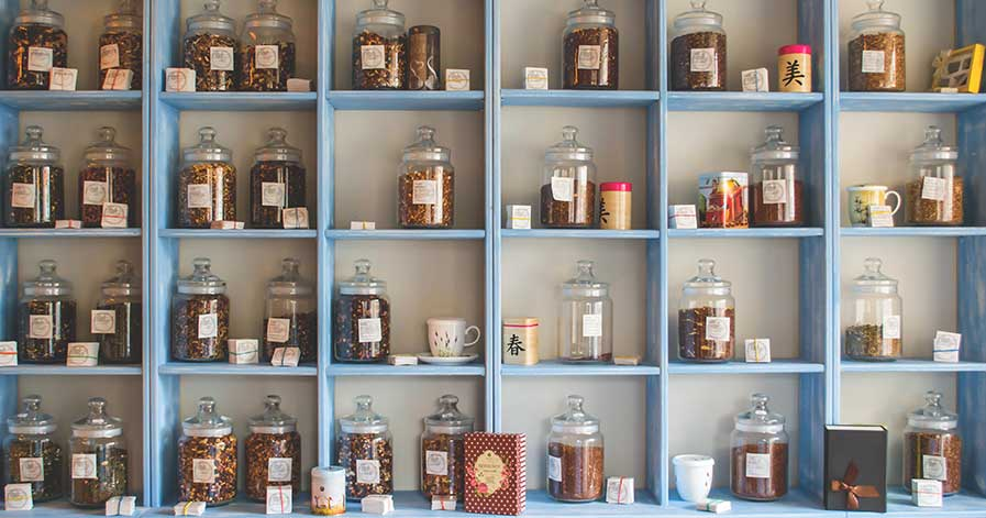 Shelves with glass jars on them