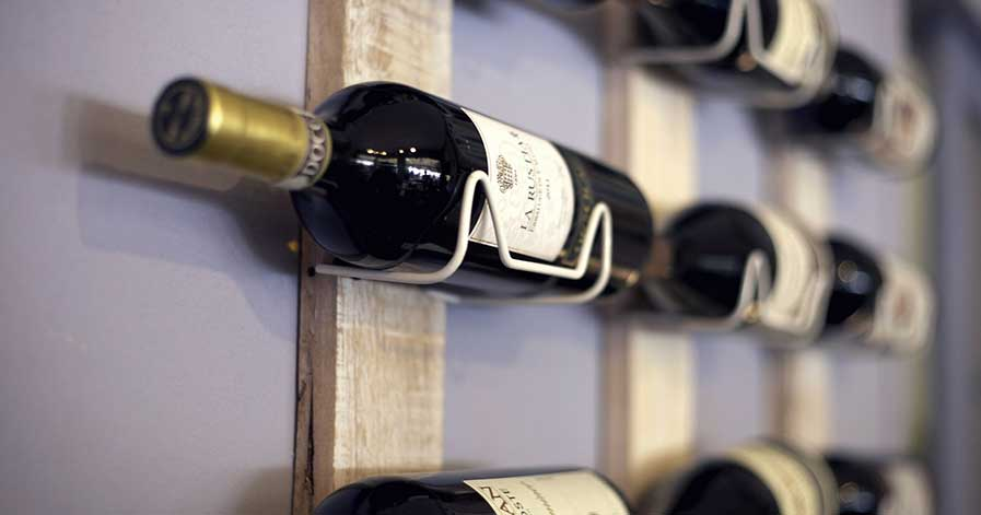 Wine on a rack mounted on wall