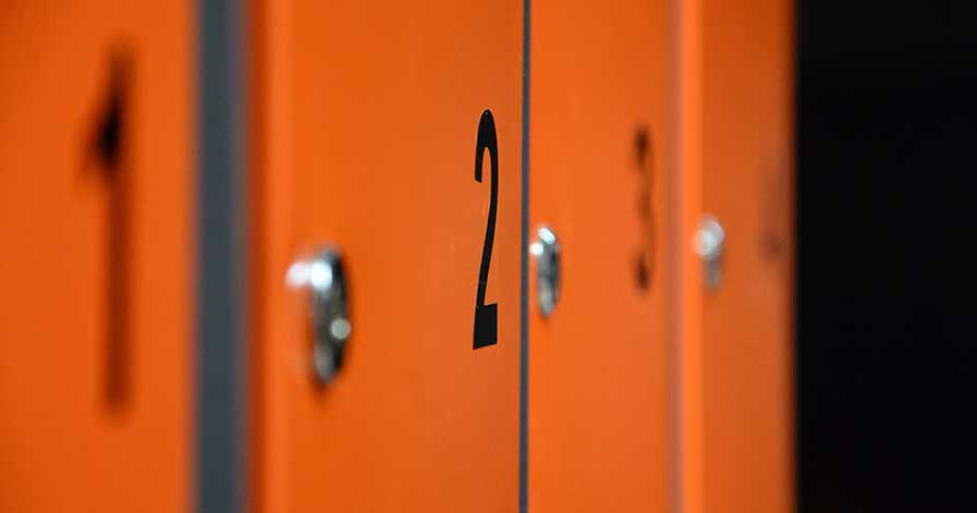 Orange lockers with numbers on them