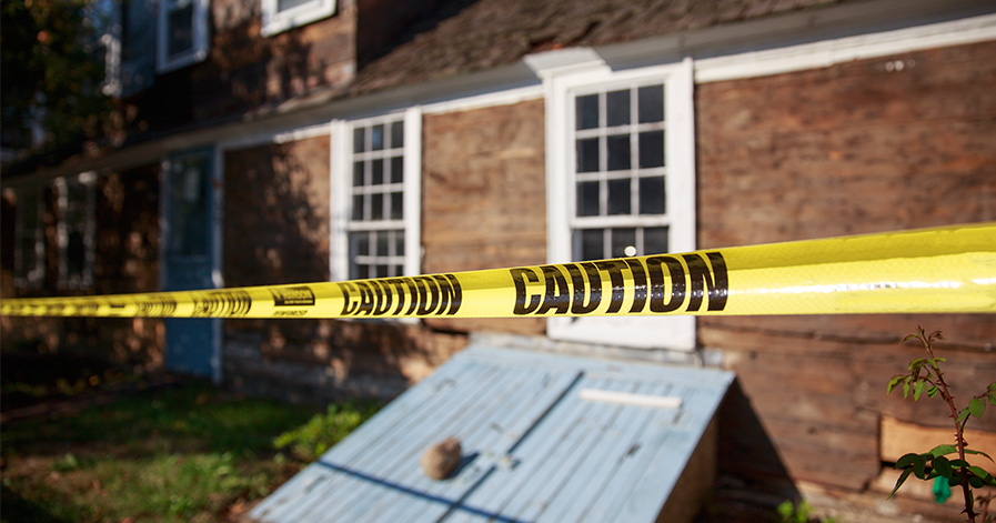 Crime scene tape in front of a house