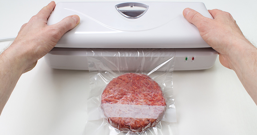 Hamburger being vacuum sealed